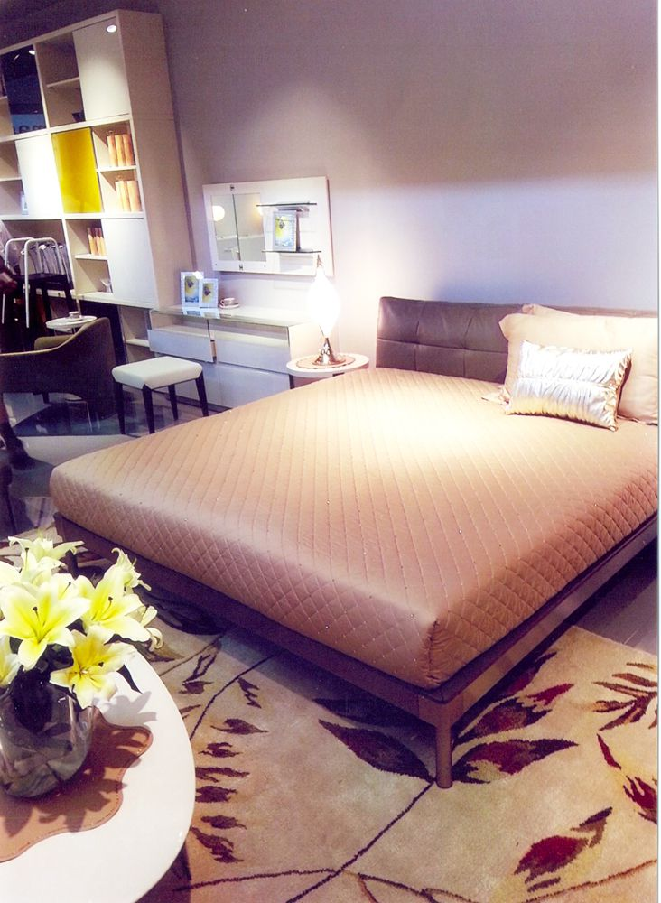 Master bed made with maximum space utilization by FLorence Homes